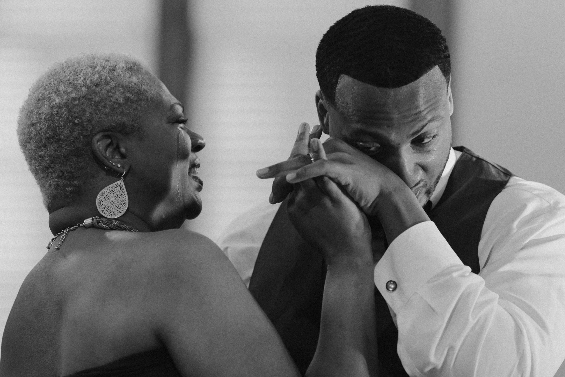 Groom and mom crying at downtown Hattiesburg, Mississippi wedding