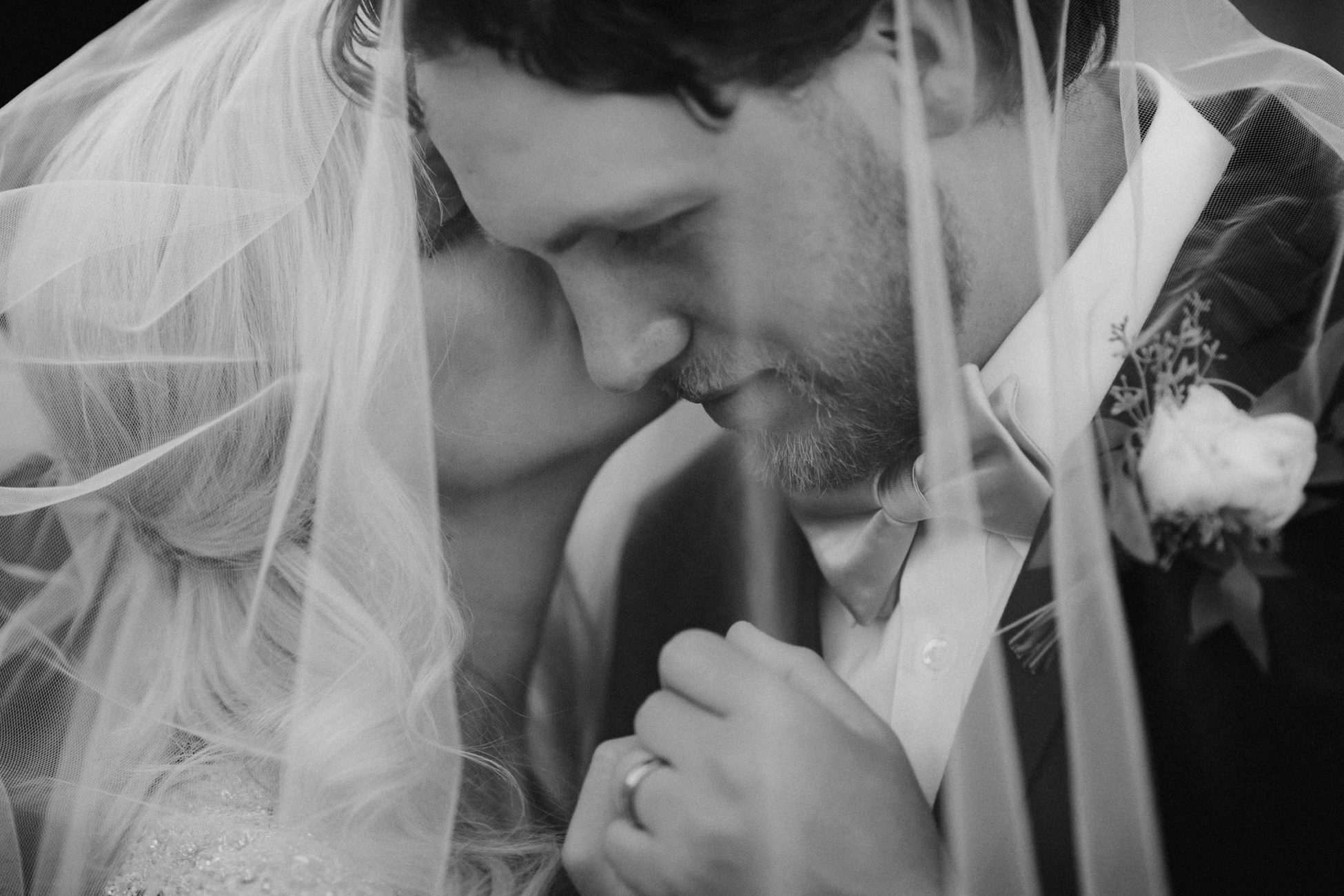 Couple under veil at Hattiesburg, Mississippi wedding