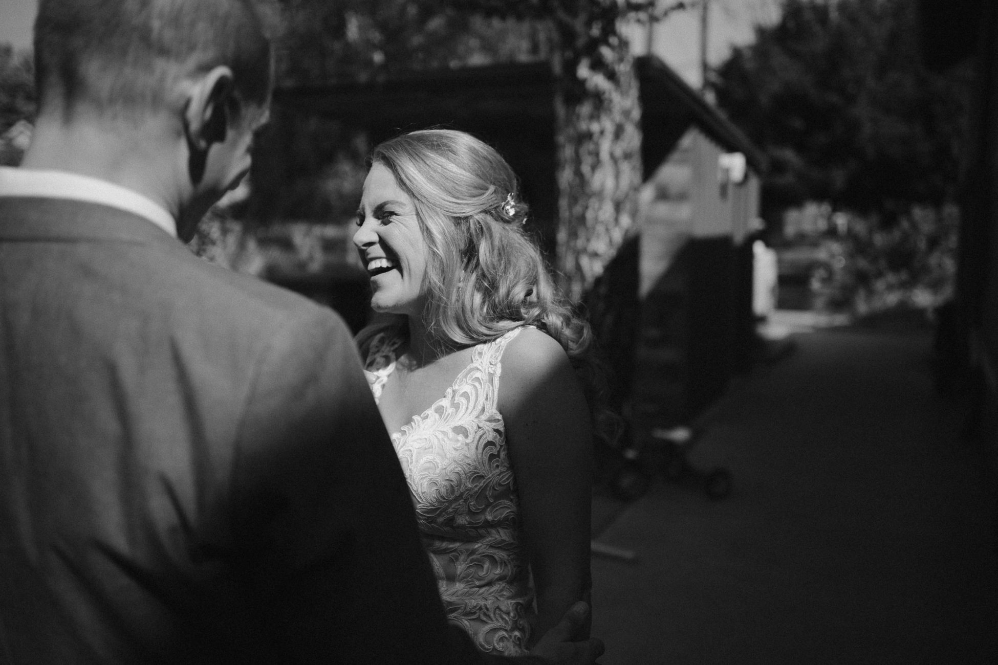 Bride laughing during first look in downtown Portland, Oregon wedding
