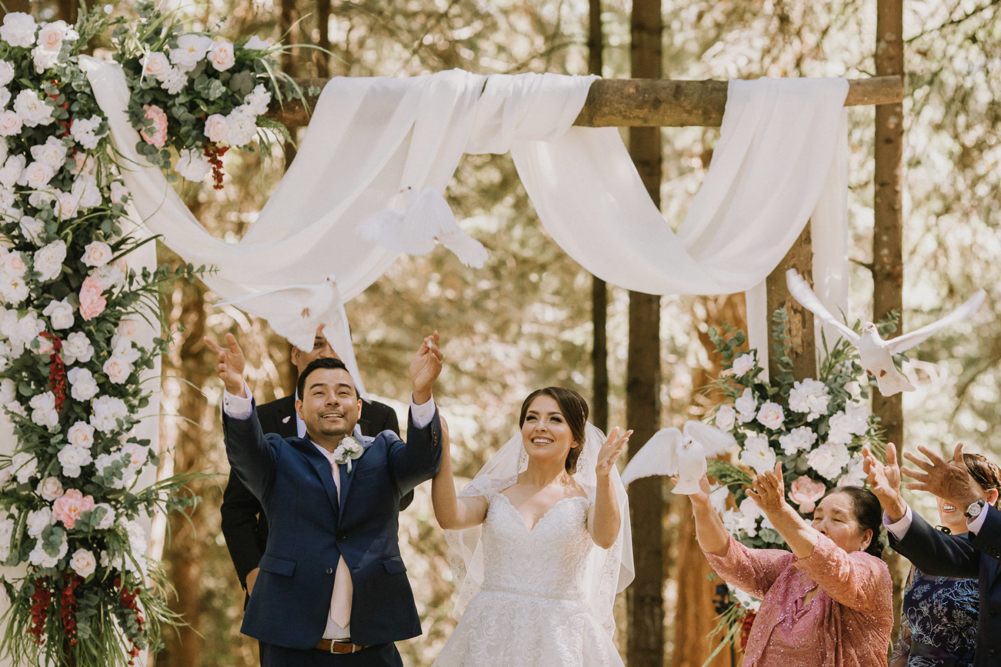 Couple releasing doves during Salem, Oregon ranch wedding